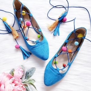Bucco Blue Suede Lace Up Flats with Pom Poms